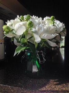 I didn't have a short vase, so I put the peonies in this glass canister and loved the effect.